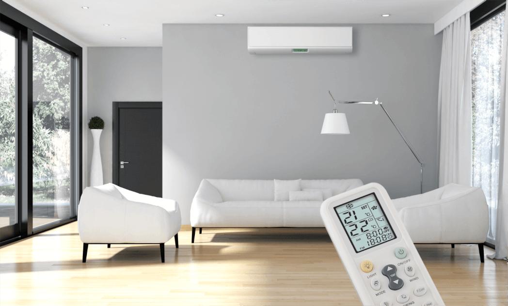 Sala com incidência de luz do sol, controle de ar condicionado em primeiro plano.